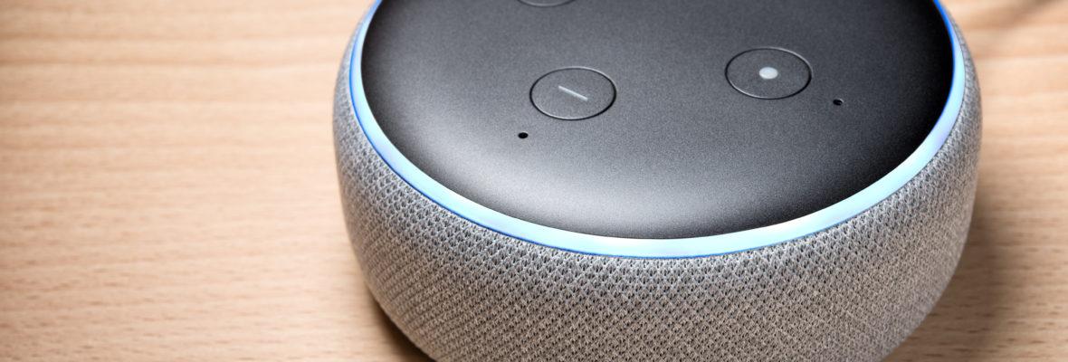 Amazon Echo Dot 3 on wooden background